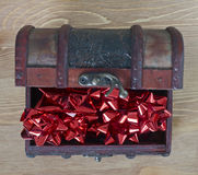 Red bows in jewellery box Royalty Free Stock Photo