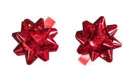 Red bows made of shiny ribbon. Two red bows made of shiny ribbon Royalty Free Stock Image