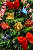 Red bows and many presents. New Year's Red bows and presents on tree tinsel Stock Photography