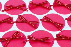 Red bows on pink dots Royalty Free Stock Image