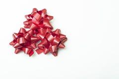 Red bows on white bottom. Chrismas Royalty Free Stock Photo