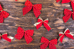 Red bows on a wooden table Stock Image