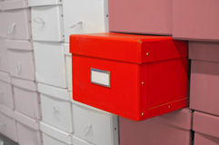 Red Box. A red box sticking out from others with simple setting Royalty Free Stock Images