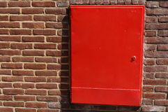 Red box. Red metal box on a wall Royalty Free Stock Images