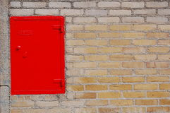 Red box. A red box in a wall with bricks Royalty Free Stock Photography