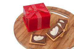 The red box with bow and chocolate biscuits Stock Images
