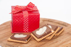 The red box with bow and chocolate biscuits Stock Image