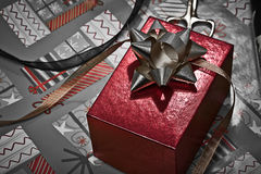 Red box with bow and wrapping paper Stock Photo