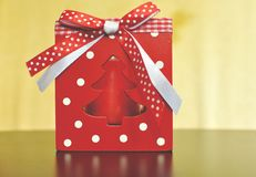 Red box with candle for table Christmas decoration with white and red bow. royalty free stock photos