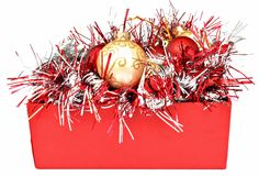 Red box  with Christmas balls Stock Photos