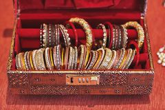 A red box with collection of glitter bracelets or bangle for indian bride royalty free stock images