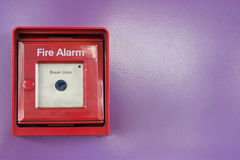Red box of fire alarm on violet wall Stock Photography