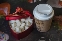 Red heart shaped box with a cup of coffee stock image