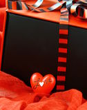 Red box with a gift and a red heart Stock Photo
