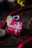 Red box with gift to Valentine's day celebration. Royalty Free Stock Image