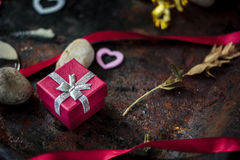 Red box with gift to Valentine's day celebration. Stock Photo