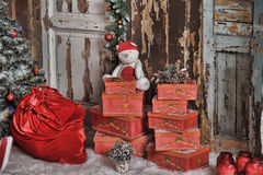 Red box with gifts. And a white teddy bear Stock Image