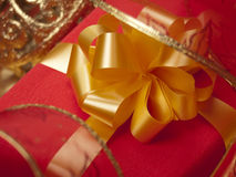 Red box with a gold bow. Royalty Free Stock Photo
