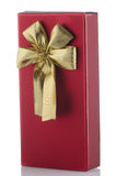 Red box with gold bow Royalty Free Stock Photos
