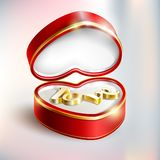 Red box with gold jewel . Red box with gold jewel. Valentines day present concept.the golden word love in a gift box.gift box greeting card love valentine`s day Royalty Free Stock Photo