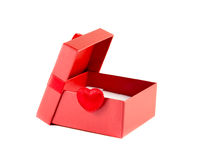 Red box with the lid open with a ribbon. On a white background Stock Image