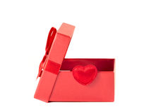 Red box with the lid open with a ribbon. On a white background Stock Photo