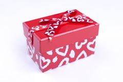 Red box with painted hearts. Red box with white hearts . Gift box for Valentine`s Day royalty free stock images