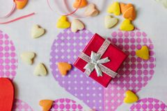 Red box with present for Valentine`s day Stock Photos
