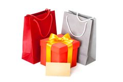 Red box with  ribbon and gift card Royalty Free Stock Image