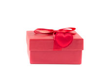 Red box with a ribbon with heart. On a white background Stock Images