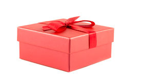 Red box with a ribbon. On a white background Stock Photography