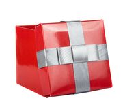 Red box and ribbon on white backgrounds. Isolated Royalty Free Stock Photography