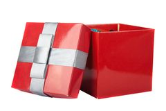 Red box and ribbon on white backgrounds. Isolated Royalty Free Stock Images