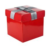 Red box and ribbon on white backgrounds. Isolated Stock Photo