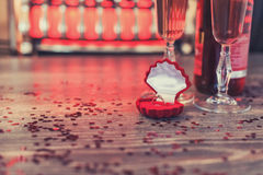 A red box with a ring, marriage proposal, Valentines Day, wine, romantic atmosphere Royalty Free Stock Photo