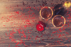 A red box with a ring, marriage proposal, Valentines Day, wine, romantic atmosphere Royalty Free Stock Image