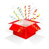 Red box with serpentine. And confetti. Gift wrapping with surprise, unexpected explosion and festive mood. A gift for Christmas and New Year. Isolated on white Stock Photos