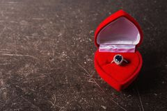 Red box with a silver ring with a black stone Stock Photo
