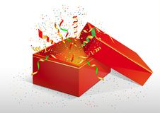 Red box with a surprise. Red box with serpentine and confetti. Gift wrapping with surprise, unexpected explosion and festive mood. A gift for Christmas and New Stock Photos