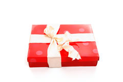 Red box tied with cream ribbon Royalty Free Stock Photo
