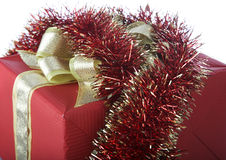 Red box and tinsel o Stock Photography