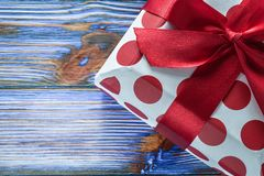 Red boxed birthday gift on vintage wooden board.  stock images