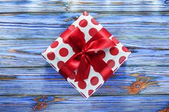 Red boxed birthday present on vintage wooden board.  stock photography