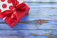 Red boxed present on vintage wooden board.  royalty free stock images