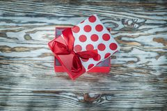 Red boxed present on vintage wooden board.  royalty free stock photography