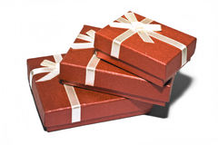 Red boxes. Three red souvenir boxes white background isolate Stock Photography