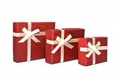 Red boxes. Three red souvenir boxes white background isolate Royalty Free Stock Image