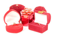 Red boxes for gifts. Many red boxes for gifts and ornaments of the jeweller on white background Stock Images