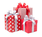 Red boxes with gifts tied with gray bows isolated on white backg Royalty Free Stock Photos