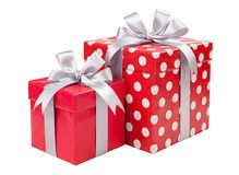 Red boxes gifts tied with gray bows isolated on Royalty Free Stock Image